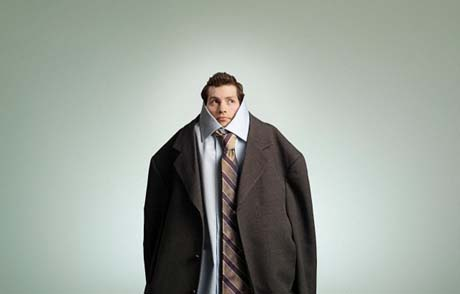 Man wearing oversized suit